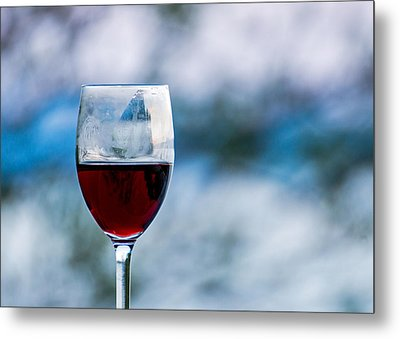 Single Glass Of Red Wine On Blue And White Background Metal Print by Photographic Arts And Design Studio