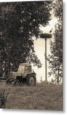 Stork Vs Tractor Metal Print by Yevgeni Kacnelson