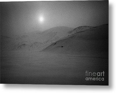 sun breaking through white out snowstorm whalers bay deception island Antarctica Metal Print by Joe Fox