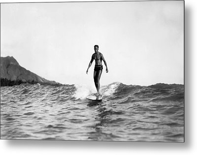Surfing At Waikiki Beach Metal Print by Underwood Archives