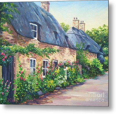 Thatched Roofs Metal Print by John Clark