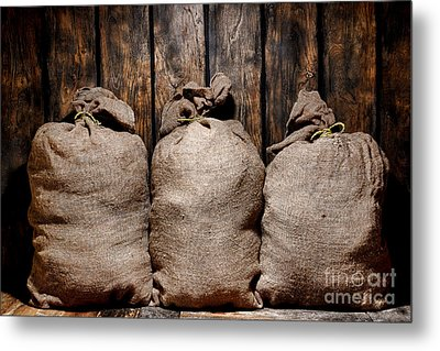 Three Bags In A Warehouse Metal Print by Olivier Le Queinec