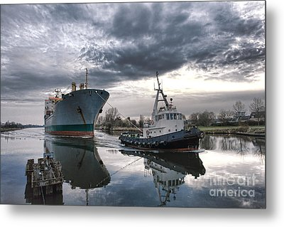 Tugboat Pulling A Cargo Ship Metal Print by Olivier Le Queinec