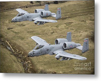 Two A-10 Thunderbolt IIs Conduct Metal Print by Stocktrek Images