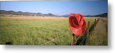 Usa, California, Red Cowboy Hat Hanging Metal Print by Panoramic Images