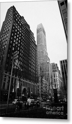 view of pennsylvania bldg nelson tower and US flags flying on 34th street from 1 penn plaza Metal Print by Joe Fox