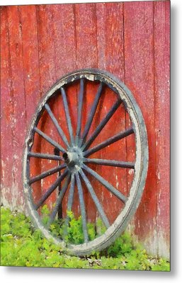 Wagon Wheel On Red Barn Metal Print by Dan Sproul