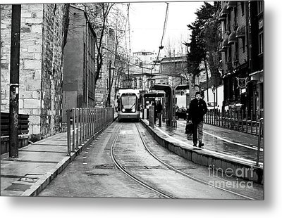Waiting For The Tram In Istanbul Metal Print by John Rizzuto