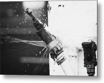 Water Escaping From A Loose Fitting Hose And Tap On Orange Post Kilkeel Harbour County Down Northern Ireland Metal Print by Joe Fox