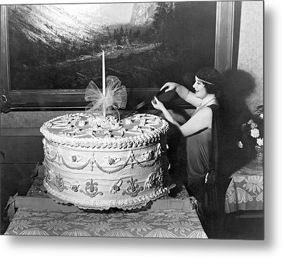Woman Cuts 250 Pound Cake Metal Print by Underwood Archives