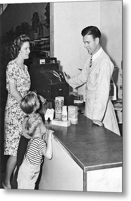 Woman Purchasing Groceries Metal Print by Underwood Archives