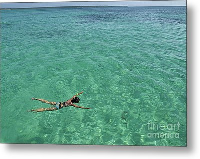 Woman Snorkeling By Turquoise Sea Metal Print by Sami Sarkis