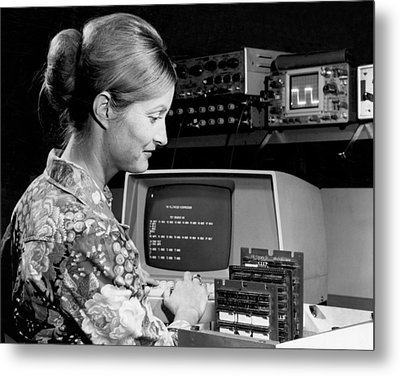 Woman Testing A Microcomputer Metal Print by Underwood Archives