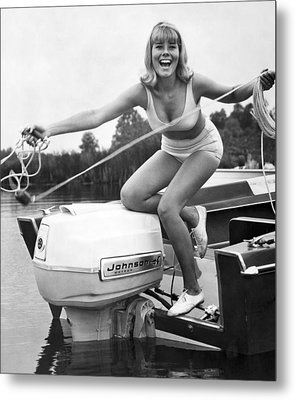 Woman Throwing A Boat Line Metal Print by Underwood Archives