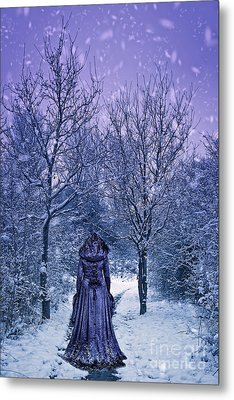 Woman Walking In Snow Metal Print by Amanda And Christopher Elwell