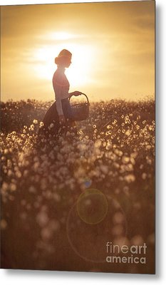 Woman With A Wicker Basket At Sunset Metal Print by Lee Avison