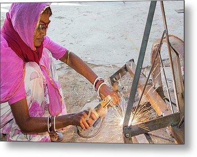 Women Welding Joints Metal Print by Ashley Cooper