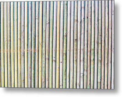 Wooden Poles Metal Print by Tom Gowanlock