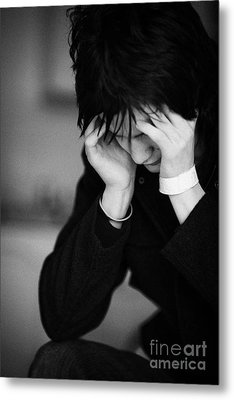 Young Dark Haired Teenage Man Sitting With His Head In His Hands Staring At The Floor Metal Print by Joe Fox