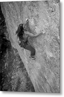A Caucasian Women Rock Climbing Metal Print by Bobby Model