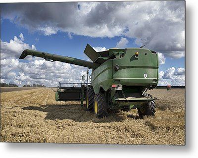 A Large Combine Harvester Machinery Metal Print by Jaak Nilson