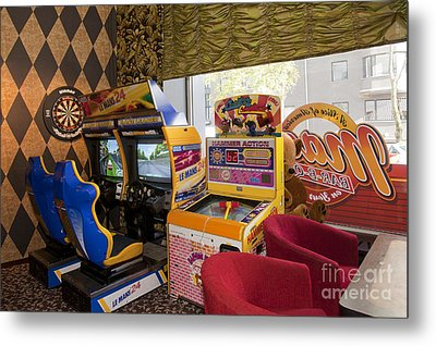 Arcade Game Machines At A Diner Metal Print by Jaak Nilson
