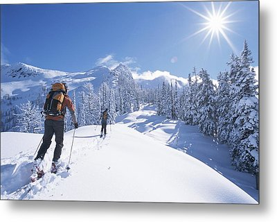 Cross-country Skiers In The Selkirk Metal Print by Jimmy Chin