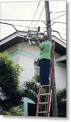 Electricity Maintenance Metal Print by David Nunuk