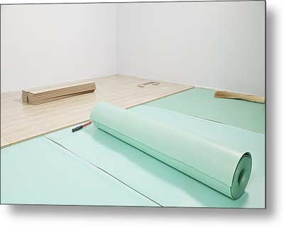 Laying A Floor. Rolls Of Underlay Or Metal Print by Magomed Magomedagaev