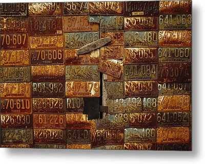 Side Of A Building Adorned With Old Metal Print by Raymond Gehman