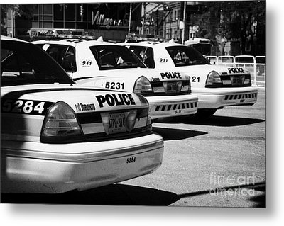 Toronto Police Squad Cars Outside Police Station In Downtown Toronto Ontario Canada Metal Print by Joe Fox