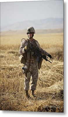 U.s. Marine Patrols A Wadi Near Kunduz Metal Print by Terry Moore