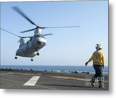 A Ch-46e Sea Knight Helicopter Prepares Metal Print by Stocktrek Images