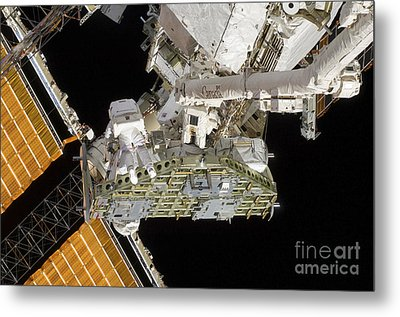 Astronauts Working On The International Metal Print by Stocktrek Images