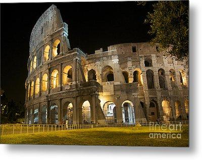 Coliseum Illuminated At Night. Rome Metal Print by Bernard Jaubert