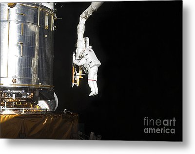 Astronaut Working On The Hubble Space Metal Print by Stocktrek Images