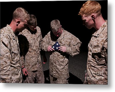 U.s. Marines Fold The American Flag Metal Print by Terry Moore