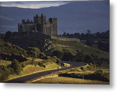 A Ancient Romanesque Castle Sits Atop Metal Print by Cotton Coulson