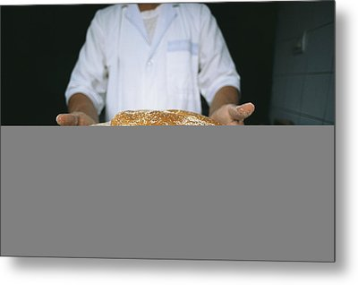 A Baker Shows His Fresh Loaves Metal Print by Heather Perry