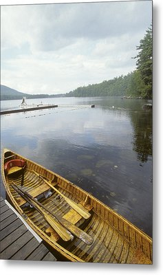 A Canoe Floats Next To A Dock Metal Print by Skip Brown