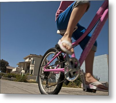 A Child Rides Her Bike Along The Beach Metal Print by Stacy Gold