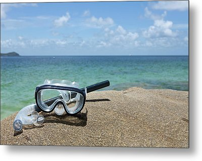 A Diving Mask And Snorkel On A Rock Near The Sea Metal Print by Caspar Benson
