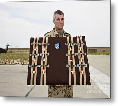 A German Soldier Holds A Display Metal Print by Terry Moore
