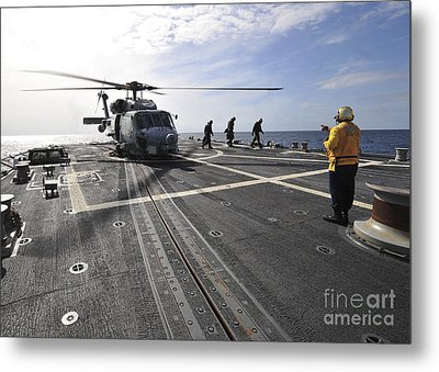 A Helicpter Sits On The Flight Deck Metal Print by Stocktrek Images