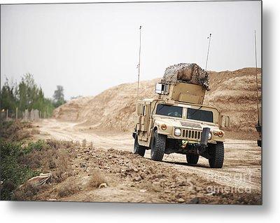 A Humvee Conducts Security Metal Print by Stocktrek Images