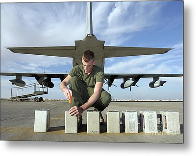 A Marine Replaces Flares In Flare Metal Print by Stocktrek Images