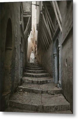 A Muslim Woman Walking Down A Steep Metal Print by Gervais Courtellemont