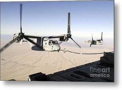 A Mv-22 Osprey Refuels Midflight While Metal Print by Stocktrek Images