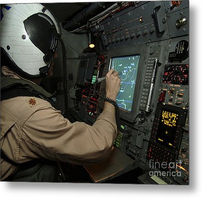 A Naval Flight Officer Tracks Aircraft Metal Print by Stocktrek Images