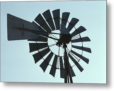 A Near-silhouette Of An Old Windmills Metal Print by Stephen St. John